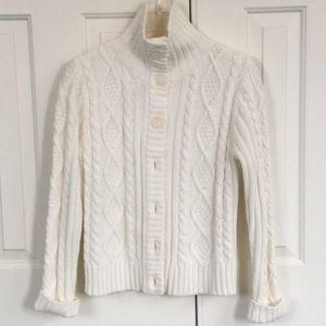 Knit sweater.